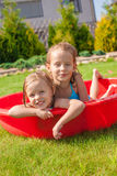 Two cute little happy girls having fun in small Royalty Free Stock Images
