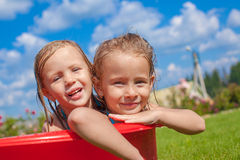 Two cute little happy girls having fun in small Stock Images