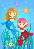 Two Cute Little Mermaids Royalty Free Stock Images