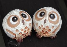 Two cute little owl figurines Stock Images
