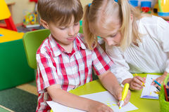 Two cute little prescool kids drawing Stock Photo