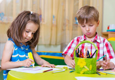 Two cute little prescool kids drawing Royalty Free Stock Photography