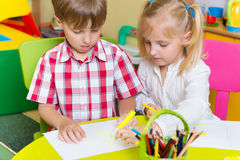 Two cute little prescool kids drawing Royalty Free Stock Photo