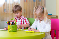 Two cute little prescool kids drawing Stock Images