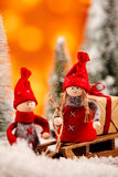 Two cute little red Christmas dolls with a sled Stock Photo
