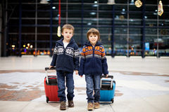 Two cute little sibling children, boys, at the airport, travelin Stock Photography