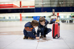 Two cute little sibling children, boys, at the airport, travelin Stock Photos