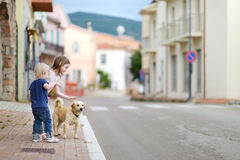 Two cute little sisters and a dog Stock Photography