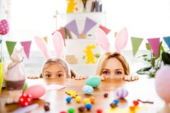 Two cute little sisters, friends wearing bunny ears, rabbit cost royalty free stock photography