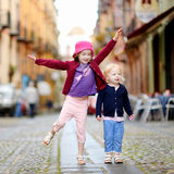 Two cute little sisters having fun outdoors Stock Photo