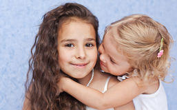 Two cute little sisters hugging Royalty Free Stock Image