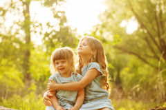 Two cute little sisters stock images