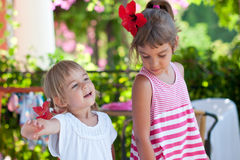 Two cute little sisters summer outdoor portrait Royalty Free Stock Photography