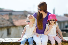 Two cute little sisters and their mother Royalty Free Stock Images