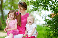 Two cute little sisters and their mother Stock Image
