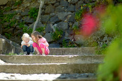 Free Two Cute Little Sisters Watching A Bug Royalty Free Stock Image - 41458306