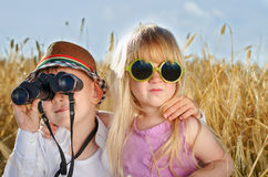 Two cute little sweethearts playing outdoors royalty free stock photos