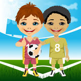 Two cute multiracial youth soccer players Royalty Free Stock Photos