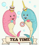 Two cute narwhal animals drinking tea with doughnuts Stock Images