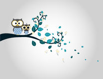 Two cute owls on a tree branch silhouette Stock Photography