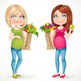 Two cute pregnant women  with paper bags fresh fruits and vegetables Royalty Free Stock Image