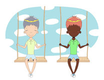 Two cute princes on a swing Royalty Free Stock Photos