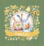 Two Cute Rabbits Hold Gifts- Eggs And Bouquet of Carrot Stock Images
