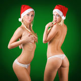 Two cute sexy topless blond girls wearing santa Stock Photography
