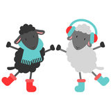 Two cute sheep in winter clothes Royalty Free Stock Photos