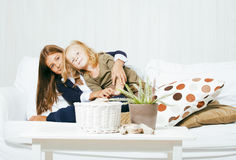 Two cute sisters at home playing, little girl in house interior Stock Image