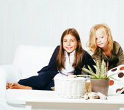 Two cute sisters at home playing, little girl in house interior Royalty Free Stock Photo