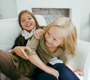 Two cute sisters at home playing Royalty Free Stock Photo