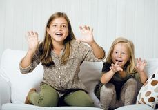 Two cute sisters at home playing Stock Photos