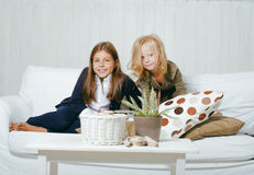 Two cute sisters at home playing Royalty Free Stock Photography