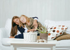 Two cute sisters at home playing Royalty Free Stock Photos