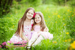 Two cute sisters in the meadow Royalty Free Stock Photo