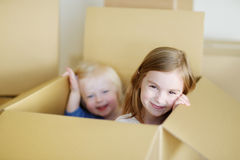 Two cute sisters moving in her new home Royalty Free Stock Photography