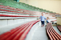Two cute sisters on a stadium Royalty Free Stock Photo