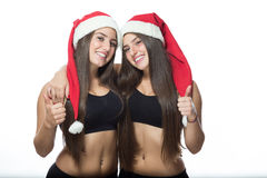 Two cute sisters twins, thumbs up Royalty Free Stock Image