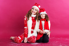 Two cute sisters are wearing winter clothes Royalty Free Stock Photo