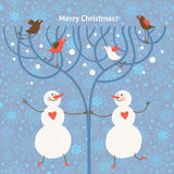 Two cute snowmans and birds Stock Image