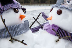 Two cute snowmen friends embracing Stock Photography