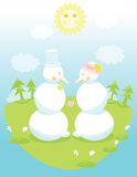 Two cute snowmen in love holding hands Royalty Free Stock Photography