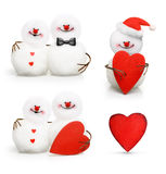 Two cute snowmen in love hugging Royalty Free Stock Photos