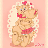 Two cute Teddy bears in love. Bears hugging and kissing Stock Image