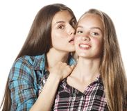 Two cute teenagers having fun together isolated on Stock Images