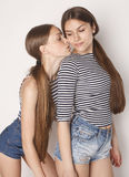 Two cute teenagers having fun together isolated on Royalty Free Stock Images