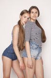 Two cute teenagers having fun together isolated on Royalty Free Stock Photo