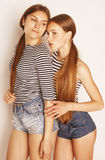 Two cute teenagers having fun together isolated on white Stock Images