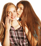 Two cute teenagers having fun together isolated on white Stock Photos